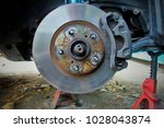 car disc break on repair... | Shutterstock . vector #1028043874