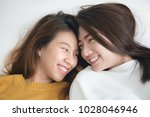 couple of young asian women on... | Shutterstock . vector #1028046946