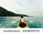 asian young woman kayaking at... | Shutterstock . vector #1028049910