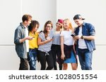 young adult friends using... | Shutterstock . vector #1028051554