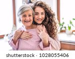 a teenage girl with mother at... | Shutterstock . vector #1028055406