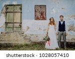 beautiful bride and groom in... | Shutterstock . vector #1028057410