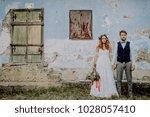 beautiful bride and groom in...   Shutterstock . vector #1028057410