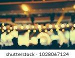 defocused entertainment concert ... | Shutterstock . vector #1028067124