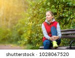 the girl rests on the bench... | Shutterstock . vector #1028067520