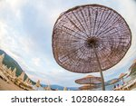 sun loungers on a beach in... | Shutterstock . vector #1028068264