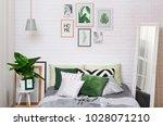 bedroom interior in gray green...   Shutterstock . vector #1028071210