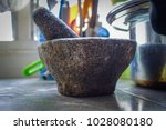 closeup of mortar and pestle | Shutterstock . vector #1028080180