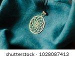 silver dream pendant on a blue... | Shutterstock . vector #1028087413