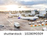 busy airport view with... | Shutterstock . vector #1028090509