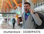 stressed out passenger after... | Shutterstock . vector #1028094376