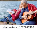 happy senior couple enjoying... | Shutterstock . vector #1028097436