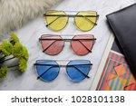 eyewear sunglasses photography | Shutterstock . vector #1028101138