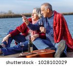 happy senior couple enjoying... | Shutterstock . vector #1028102029