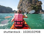women are kayaking in the open... | Shutterstock . vector #1028102908
