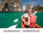 women are kayaking in the open... | Shutterstock . vector #1028103310