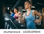 young people running on a... | Shutterstock . vector #1028109844