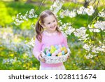 child on easter egg hunt in... | Shutterstock . vector #1028111674