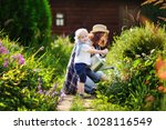 cute toddler boy and his young...   Shutterstock . vector #1028116549