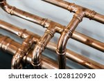 copper pipes and fittings for... | Shutterstock . vector #1028120920