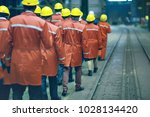 workers  helmets at the factory ...   Shutterstock . vector #1028134420