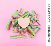 Small photo of the heart on rainbow bubble gum. metaphor. non-traditional orientation symbol. creative concept . minimal. symbolism