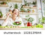 young woman eating healthy food ... | Shutterstock . vector #1028139844