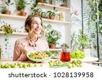 young woman eating healthy food ... | Shutterstock . vector #1028139958