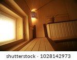 sauna  wooden interior baths ... | Shutterstock . vector #1028142973