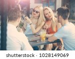 twin women in cafe outdoor.... | Shutterstock . vector #1028149069