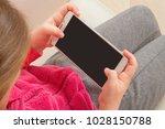 Little Girl Holding Smartphone...