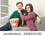 girl and boy watching tv with... | Shutterstock . vector #1028151130