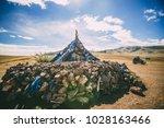 shamanic buddhist stupa on the... | Shutterstock . vector #1028163466