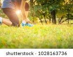 athlete woman tying running... | Shutterstock . vector #1028163736