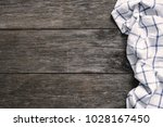 textile on old wooden... | Shutterstock . vector #1028167450
