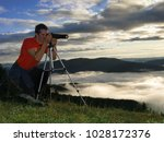 young man taking photos in... | Shutterstock . vector #1028172376
