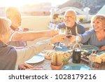 happy senior friends having fun ... | Shutterstock . vector #1028179216