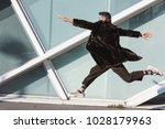 handsome indian man jumping in... | Shutterstock . vector #1028179963