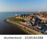 lighthouse of urk on the rocky... | Shutterstock . vector #1028181088