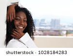 beautiful smile on babe leaning ... | Shutterstock . vector #1028184283