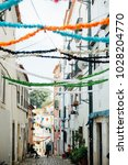 streets decorated for the saint ... | Shutterstock . vector #1028204770