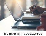 man  freelancer writing on... | Shutterstock . vector #1028219533