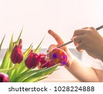 child's hands with a brush...   Shutterstock . vector #1028224888
