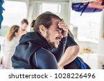 diver preparing to dive into... | Shutterstock . vector #1028226496