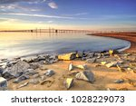 stone silent sunrise on the... | Shutterstock . vector #1028229073