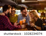 friends in the pub. drinking... | Shutterstock . vector #1028234074