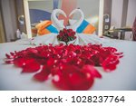 Stock photo honeymoon bed look like heart shape with rose petals for honeymoon lover in the white bed of the 1028237764