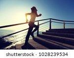 sporty fitness female runner... | Shutterstock . vector #1028239534