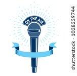 3d microphone vector... | Shutterstock .eps vector #1028239744