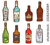 glass bottles alcohol drinks... | Shutterstock .eps vector #1028243089